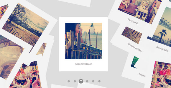 Flat Style Scattered Polaroid Gallery in JavaScript